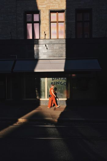 Side View Of Woman Walking On Street