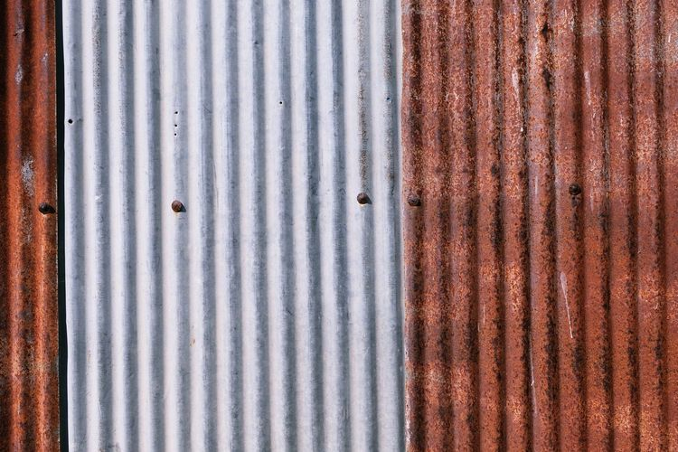 Architecture Backgrounds Close-up Corrugated Corrugated Iron Damaged Day Full Frame Iron Iron - Metal Metal No People Old Pattern Rusty Sheet Metal Shutter Silver Colored Striped Textured  Weathered