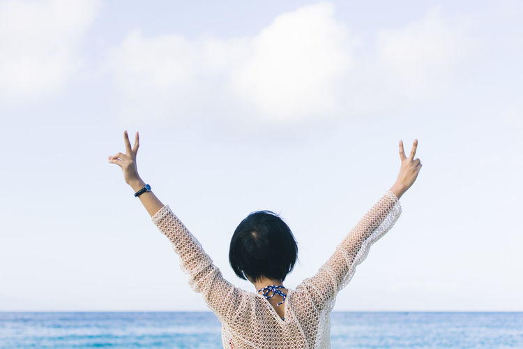 Arms Raised Beauty In Nature Day Gesturing Horizon Over Water Leisure Activity Lifestyles Nature One Person Outdoors Real People Rear View Scenics Sea Sky Water Women First Eyeem Photo