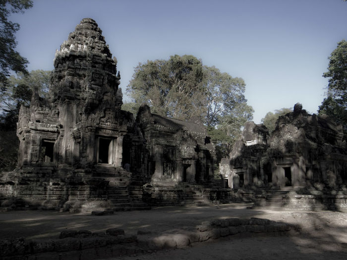 Angkor Wat Daylight Building Damaged Monument Tourism Tourist Attraction  Tourist Destination Travel Destinations Travel Photography Outdoors Cambodia ASIA Asian  Angkor Wat Monument Dream Outdoor Photography Magic Old Ruins Sculpture Sculpted Idol Ancient History Cambodian Culture Stone Material Buddhism Archaeology Historic