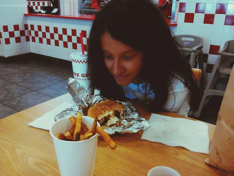 My granddaughter eating a burger at 5 Guys Taking Photos Enjoying Life Eating