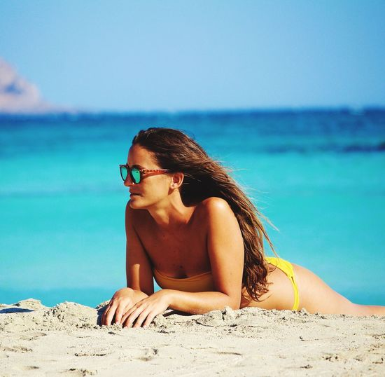 Live For The Story Beach Sea Sand One Person Water Young Adult Real People Leisure Activity Bikini Young Women Beautiful Woman Beauty In Nature Lifestyles Nature Summer Outdoors Vacations Beauty Relaxation Sunlight Greece Crete Elafonisi Sommergefühle EyeEm Selects Your Ticket To Europe