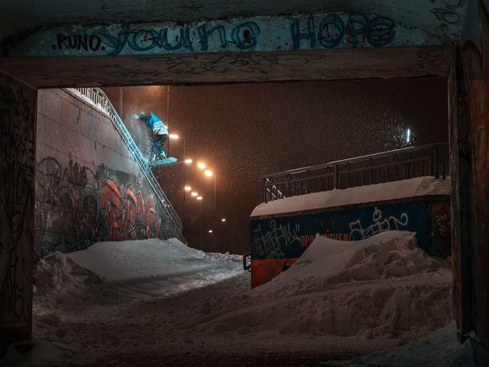 Illuminated text on snow at night