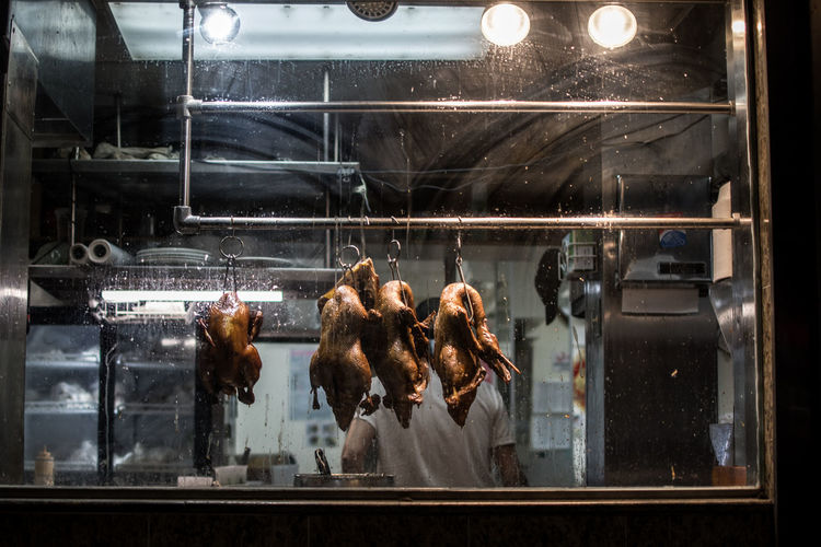 Meat hanging in glass window
