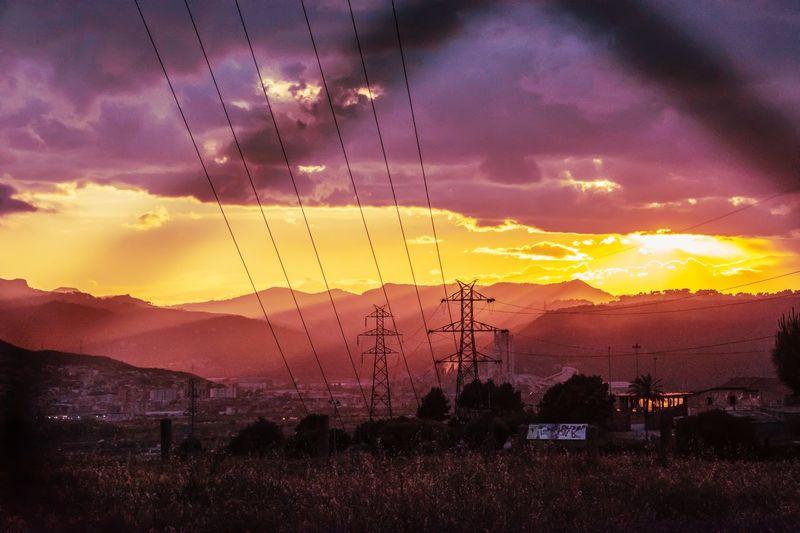 Sunset after the storm Sunsets Mountain Sunset Technology Pink Color Sun Silhouette Dramatic Sky Sky Cloud - Sky Electricity Pylon Electricity Tower Electricity  Power Cable Power Line  Electric Pole