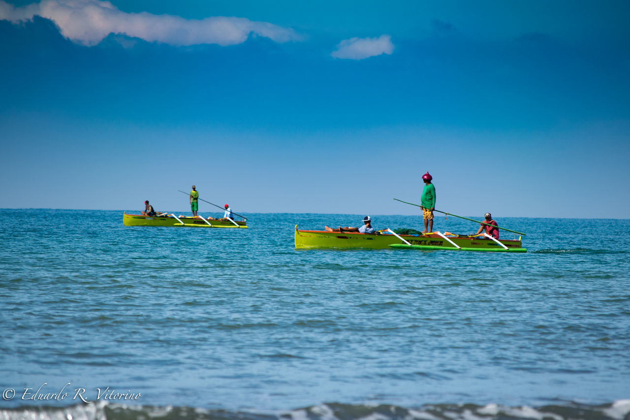 sea, sky, adventure, nautical vessel, real people, day, nature, oar, transportation, men, water, outdoors, horizon over water, leisure activity, vacations, scenics, togetherness, blue, beauty in nature, outrigger, adult, people