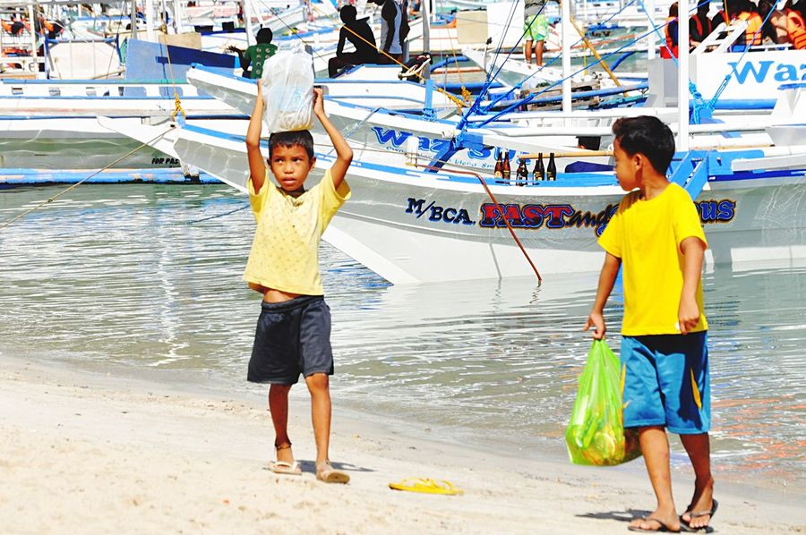 Original Experiences the kids of Palawan Elnido Island Philippines work beofre they can play they have to finish the dally home and family work then they are free to play on this amazing Beach