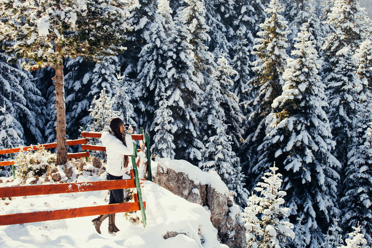 woman travel in winter forest and mountains. snowy forest Beautiful EyeEm Best Shots Frozen Travel Winter Wintertime Beauty In Nature Cold Cold Temperature Day Female Freeze Leisure Activity Long Hair Mountain Nature Outdoors Pine Tree Sexygirl Snow Standing Tourism Tree Walking Young Adult