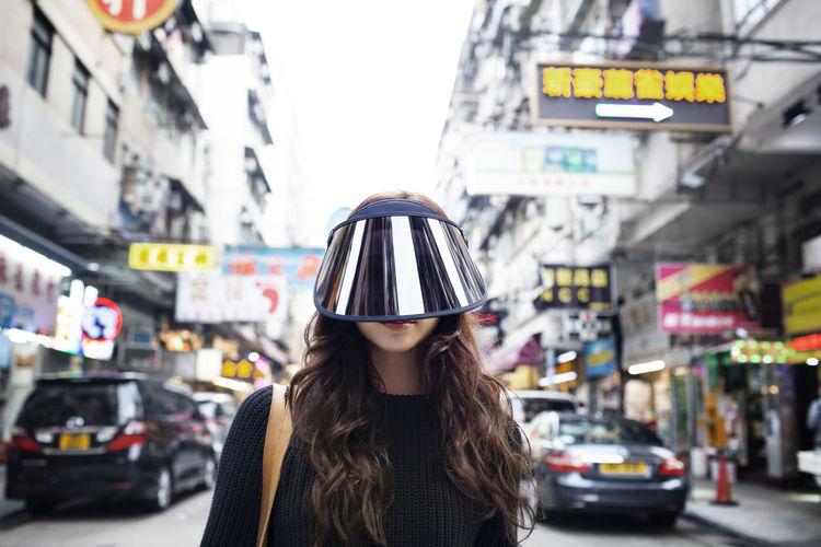 Woman with umbrella on city street