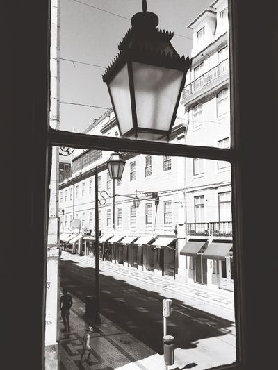 Através da vidraça... Street Lamp Lisbon Lounge Hostel Arquitecture Travel Like A Tourist Get To Know Your Country Old Buildings Not Forgotten Capital City Blackandwhite Photography Afternoon Sun Urban Geometry Old Town Traffic Lights Black & White Urban Photography LisbonLight Lisbonlovers Portuguese Architecture Calçada Portuguesa Urbanholidays