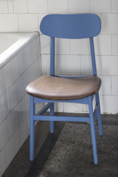 Blue chair in a rustic bathroom Blue Wave Chair Rustic StillLifePhotography Abandoned Absence Bathroom Sink Blue Sky Flooring Furniture Indoor Melancholy Moody No People Sad Sadness Seat Still Life Vertical Wood - Material