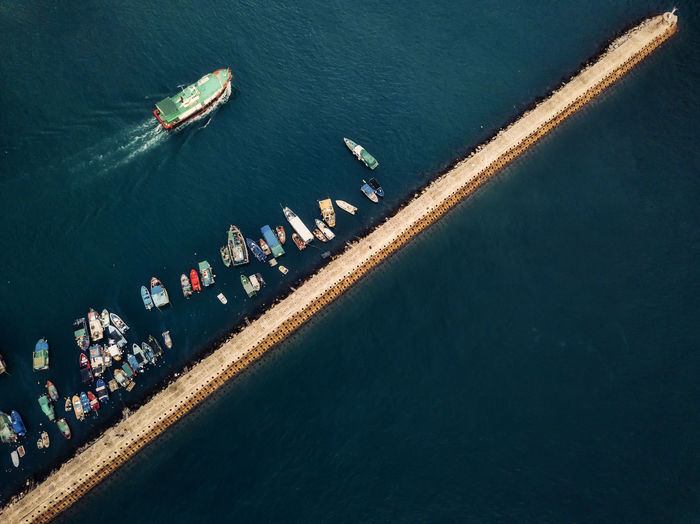 Small fishing boats near the wave barrier in aberdeen bay hong kong