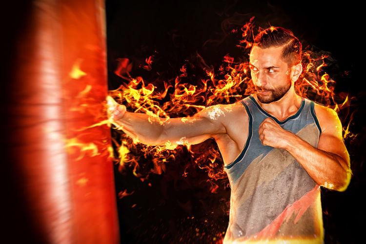 Digital composite image of man hitting punching bag