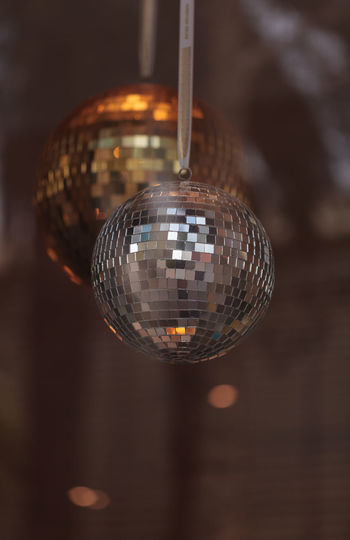 Silver and gold disco balls hang from the ceiling on New Years eve Arts Culture And Entertainment Day De Disco Ball Disco Balls Gold Hanging Illuminated Indoors  Music New Year Nightclub Nightlife No People Party Party - Social Event Reflection Silver  Sphere