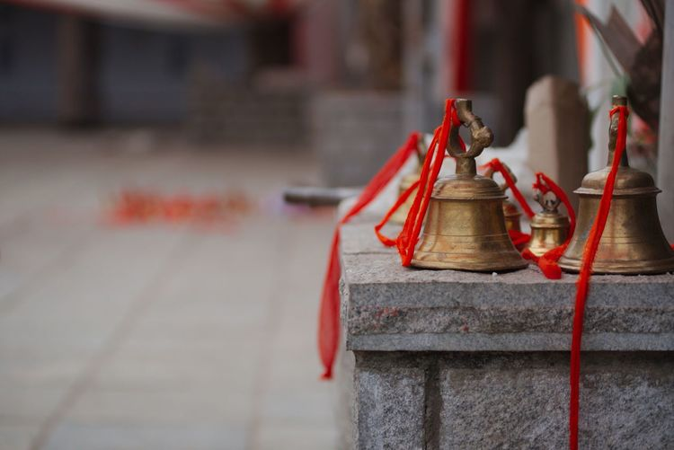 Bells With Red Ribbons In Temple