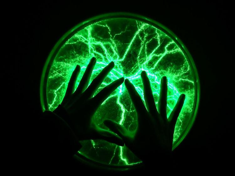 Black Background Carolinensiel Circle Close-up Dark Detail Glowing Green Color Green Flash Hands Illuminated Phänomania Plasma The Photojournalist - 2016 EyeEm Awards Color Palette
