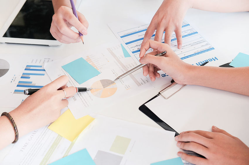 Business people Consulting and business planning. Adult Business Cooperation Coworker Design Professional Group Of People Hand High Angle View Human Body Part Human Hand Indoors  Men Occupation Office Pen People Planning Real People Table Teamwork Women Working