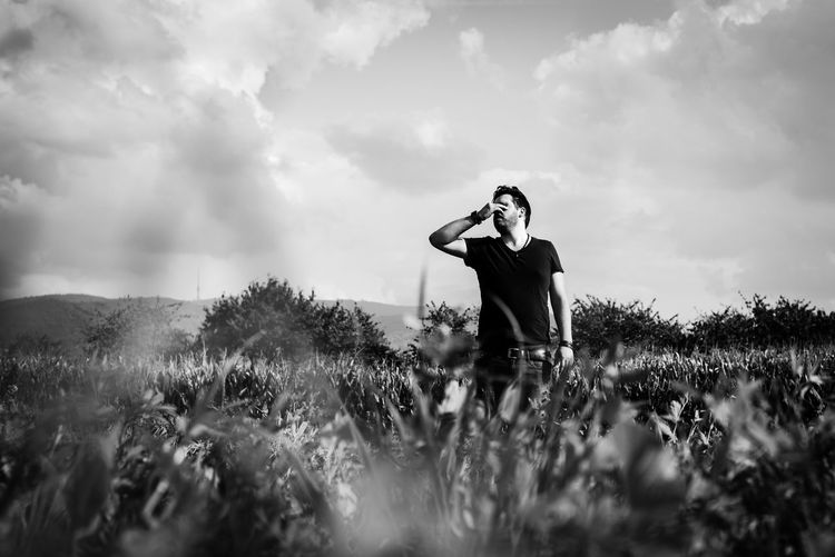 I can't Black & White Unusual Beauty In Nature Black And White Blackandwhite Casual Clothing Cloud - Sky Day Field Grass Growth Leisure Activity Lifestyles Nature One Person Outdoors Plant Real People Sky Standing Young Adult Young Women