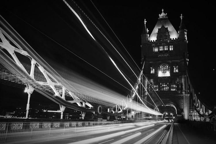Light Trails On Illuminated Tower Bridge At Night