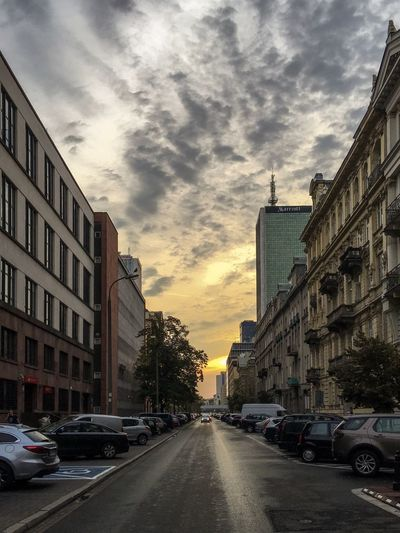 Architecture Building Exterior City Built Structure Cloud - Sky Sky Car Land Vehicle Street Road Outdoors No People Day Way Ahead Sunset Downtown