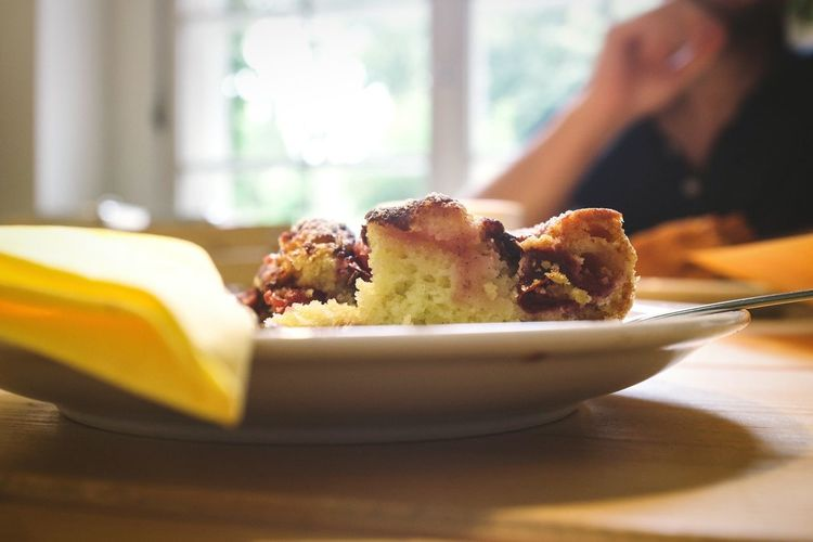 Close-Up Of Plum Cake Slices In Plate On Table