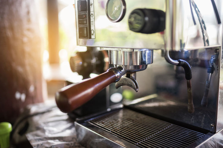 Close-up of coffee maker in cafe