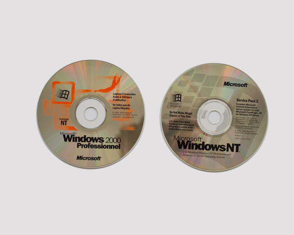 Old Version Microsoft Windows CD's windowsNT and windows2000 White Background Circle Studio Shot Geometric Shape Communication Shape Indoors  Close-up Cut Out No People Technology Still Life Text Single Object Western Script Copy Space Number Arts Culture And Entertainment Retro Styled Electrical Equipment Microsoft Windows Cd Old Windows Cd Software Development Operating System