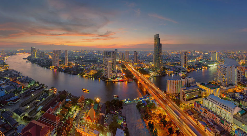 U-Curve of Chao Phraya River, Bangkok City, Thailand Bangkok Cityscape Downtown Financial District  Thailand Aerial View Architecture Building Exterior Buildings Built Structure Chao Praya River City Cityscape Downtown District High Angle View Illuminated Outdoors River Road Sky Skyscraper Sunset Taksin Bridge Travel Destinations Urban Skyline