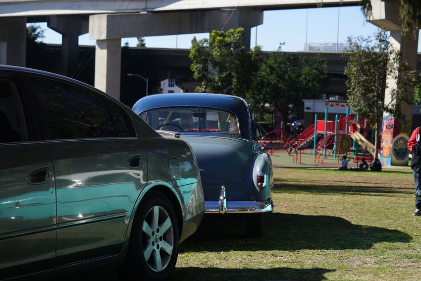 CarShow Cars Chicano Park OLD NEW Transportation Auto Bridge Built Structure Car Classic Car Modern Car Classic Modern Compare Contrast Day Land Vehicle Mode Of Transport Neighborhood No People Old Car New Car Outdoors Pair Sky Stationary Transportation Two Cars