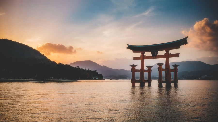 Japan Landscape Landmarks Water Sunset Sky Religion Belief Spirituality Beauty In Nature Scenics - Nature Tranquility Nature Waterfront Tranquil Scene Lake Mountain Orange Color Non-urban Scene Cloud - Sky Architecture Built Structure Outdoors No People Shrine