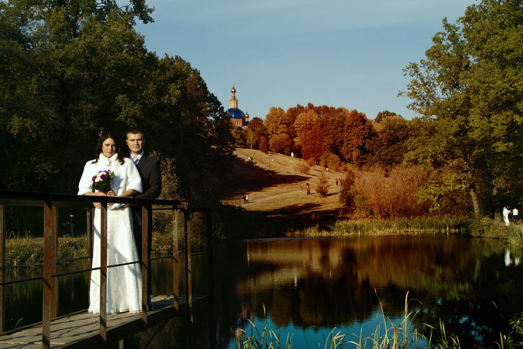 Autumn Beauty In Nature Day Lake Marriage  Married Men Nature Outdoors People Sky Togetherness Tree Two People Water Wedding Day Wedding Dress Wedding Photography Women Young Adult Young Women