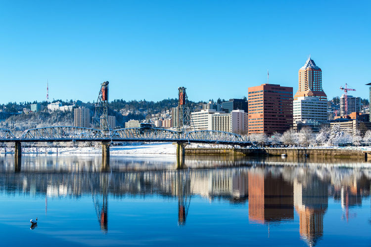 Stunning view of Portland and the Hawthorne Bridge reflected in the Willamette River Architecture Bridges City Cityscape Downtown Ice Mirror Oregon Pacific Portland Reflection Willamette River  Winter Bridge Cold Colorful Conventioncenter Infrastructure Morrison Northwest Park River Snow Urban Waterfront