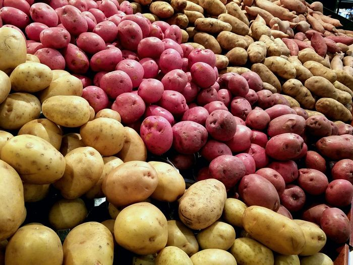 Close-up of potatoes in market stall