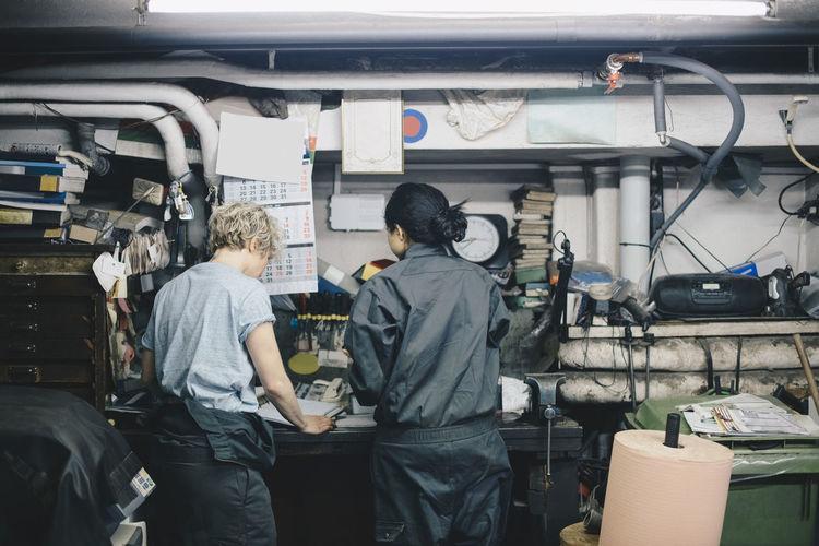 Rear view of men working