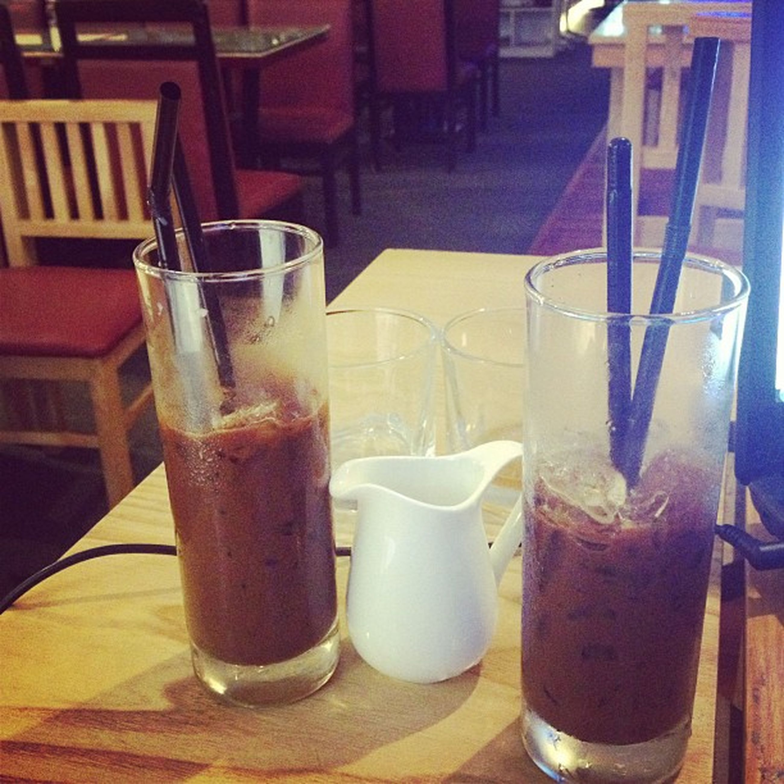 drink, food and drink, refreshment, table, drinking glass, freshness, indoors, still life, alcohol, drinking straw, close-up, restaurant, juice, glass, coffee - drink, healthy eating, glass - material, cocktail, frothy drink, focus on foreground