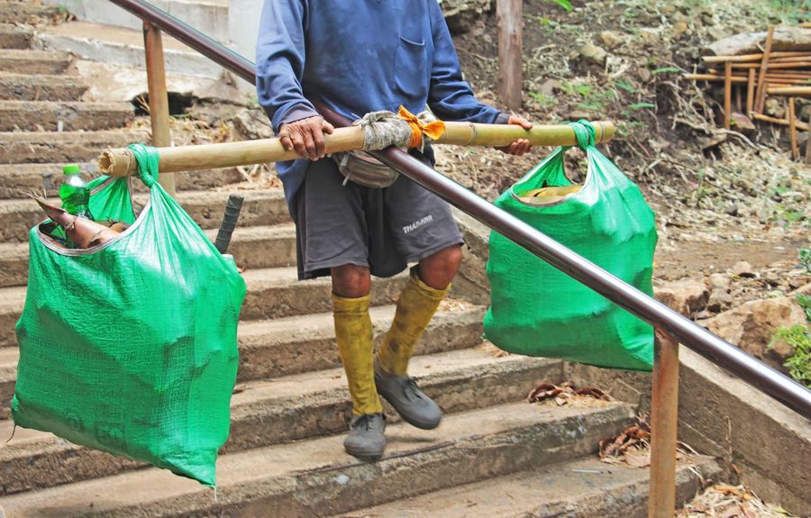 Holding Casual Clothing Nature Bag Day People Plastic Environmental Issues Plastic Bag Outdoors Real People Environmental Conservation Recycling Men Lifestyles Green Color Cleaning Environment Adult Gardening Polythene Responsibility Sustainable Lifestyle Environmentalist