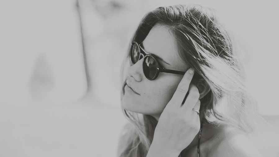 Close-up of woman in sunglasses at home
