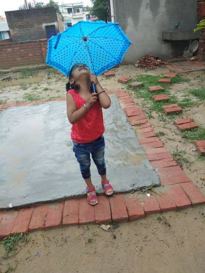 my cutie 💓 Water Full Length Childhood Child Wet Holding Standing RainDrop Weather Rainy Season Umbrella Below Under Monsoon Puddle Rainfall Sheltering Underneath Shelter Beach Umbrella Rain Spraying Drop Torrential Rain Love Is Love The Fashion Photographer - 2018 EyeEm Awards The Photojournalist - 2018 EyeEm Awards The Still Life Photographer - 2018 EyeEm Awards The Portraitist - 2018 EyeEm Awards EyeEmNewHere The Street Photographer - 2018 EyeEm Awards The Great Outdoors - 2018 EyeEm Awards The Creative - 2018 EyeEm Awards World Cup 2018