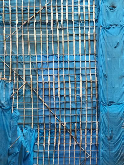 Bamboo scaffolding on blue nets Construction Site Building Exteriors Travel Destinations Hong Kong Blue Net Bamboo Scaffolding Blue Day Pattern Built Structure No People Architecture Outdoors Full Frame Safety Backgrounds Protection Security The Creative - 2019 EyeEm Awards