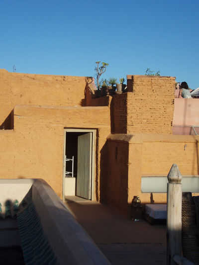 Adventure Africa Architecture Arid Climate Blue Sky Desert Door Marrakech Medina Morocco Peaceful Plants Roof Rooftop Serene Shadow Shadows Sky Stone Wall Sun Sunlight Travel Warm Colors Warmth