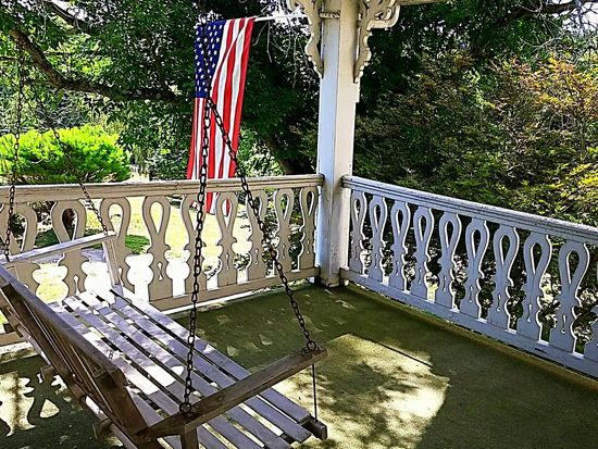 Railing Flag Porch Swing Porchswing Porch Railing Porch Balcony Covered Patio Old Fashion Detailed Wood Balustrade American Flag