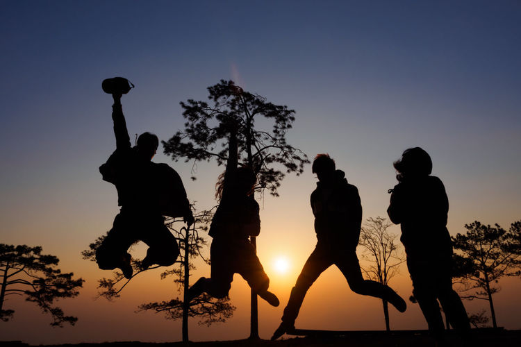 Success to destination is travel with friends and jump together Amity Dance Friends Fun Happiness Jump Clear Sky Day Enjoying Life Friendship Full Length Leisure Activity Lifestyles Low Angle View Men Nature Outdoors People Real People Silhouette Sky Sunset Together Togetherness Tree