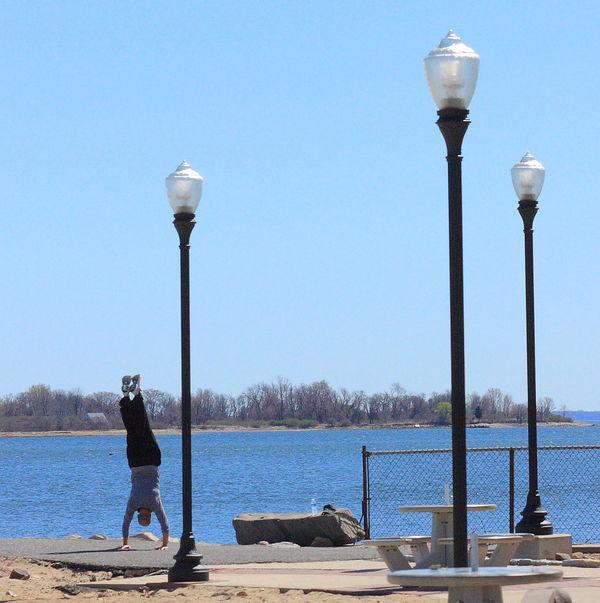 Handstand  Lamp Posts Outdoors Water