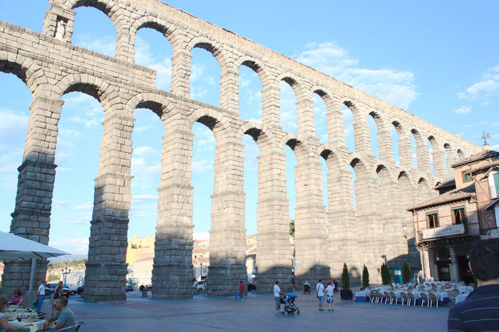 Still in use Acueducto Acueducto-Segovia Acueductoromano Aqueduc Aqueduct Architecture Built Structure Day Famous Place History In Front Of Large Group Of People Outdoors Roman Roman Building Segovia Sky The Past Tourism Travel Travel Destinations