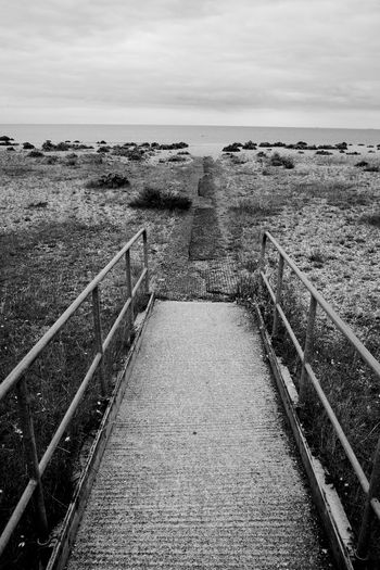 The Buoy Black & White Beach Blackandwhite Buoy Day Hand Rail Horizon Over Water Nature Outdoors Pebbles Railing Sea Sky The Way Forward Tranquil Scene Tranquility Water