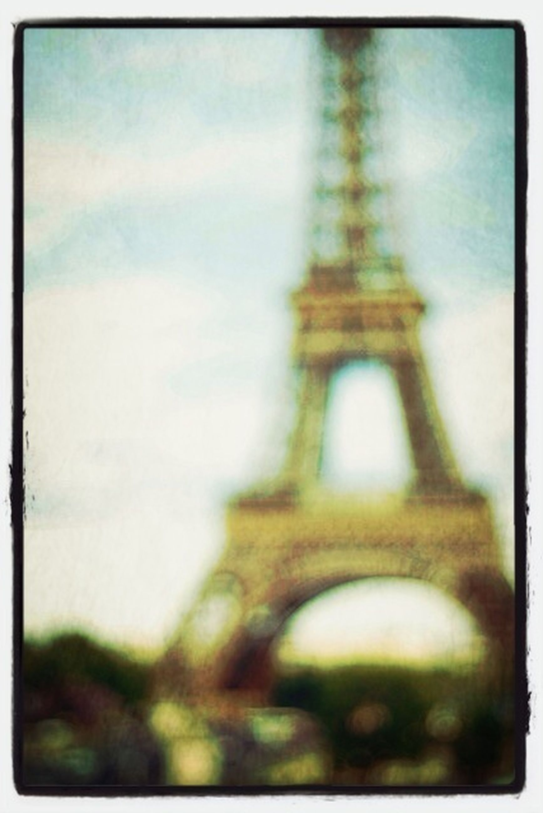 transfer print, architecture, built structure, auto post production filter, sky, low angle view, building exterior, tower, metal, international landmark, selective focus, famous place, tall - high, cloud - sky, outdoors, travel destinations, no people, cloud, connection, city