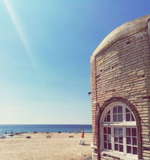 A quiet far place where you may only the sea, and the sea only laying beside the buildings. Alexandria Beach Restaurant Architecture Cityscape No People Beauty In Nature EyeEm Gallery Sunlight Eyem Best Shots Egypt Outdoors Place Of Heart