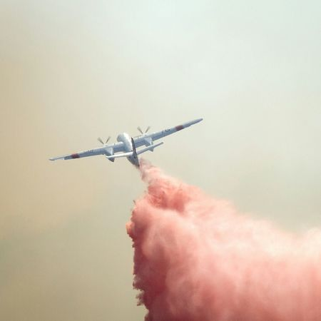 Dropping fire retardant on a hillside fire. Monrovia California Putting Out A Fire Smoke Aircraft FireFighting