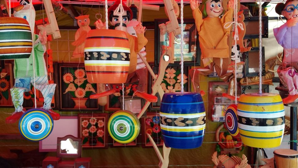 Traditional toys stand Handcraft Mexico Multi Colored No People Object Puppet Toys Yo-yo