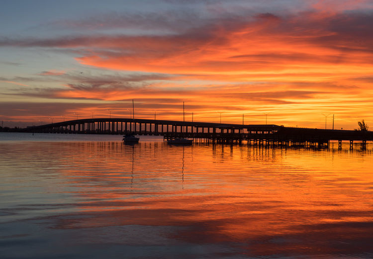 Sunrise Indian River Indian River Lagoon Sunset Melbourne, Florida Bridge Bridge - Man Made Structure Built Structure Cloud - Sky Colorful Sky Nature No People Orange Color Outdoors River Sky Sunrise Water Waterfront